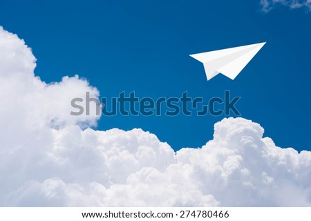 Paper airplanes in blue sky - stock photo