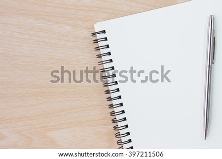 paper and pen on wood table / blank notbook copy space for message or text - stock photo
