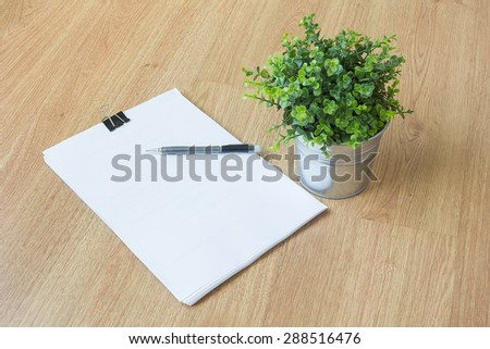 paper and pen on wooden floor - stock photo