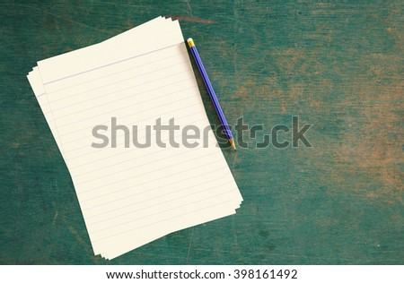 Paper and pencil on board the old green 3D rendering. - stock photo