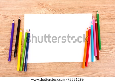 Paper and pencils on the wooden table - stock photo
