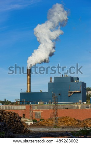 Paper and pulp factory spewing out steam