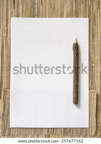 Paper and wood Pencil on Natural background - stock photo
