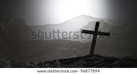 Paper art show a cross on the mountain background - stock photo