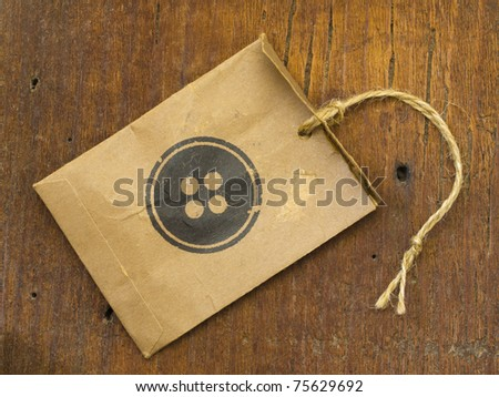 paper bag with button as a label - stock photo