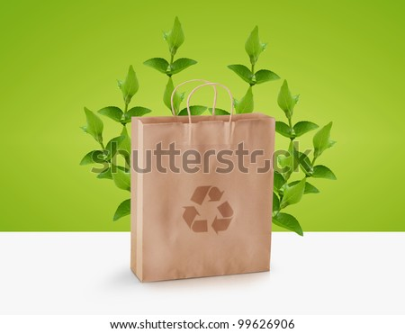 paper bag with green twig and recycle sign, Ecological awareness concept - stock photo