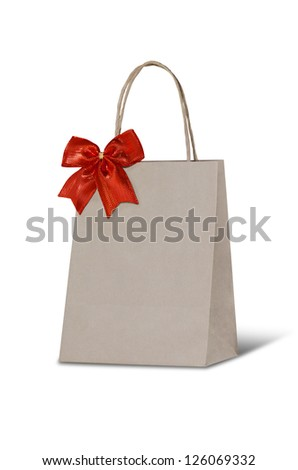 Paper bag with red ribbon - stock photo