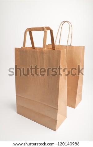 Paper bags on white background. Consumerism symbol.