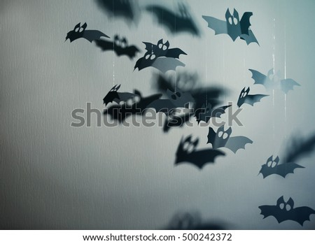 Paper bats on grey background as Halloween decor