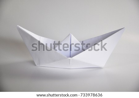 Paper Boat Isolated on White Background.Origami paper boat.Child hood work.Child creations.