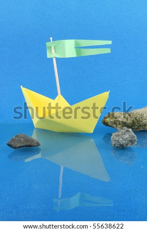 Paper boat -  spots on a blue background are given a background paper - stock photo