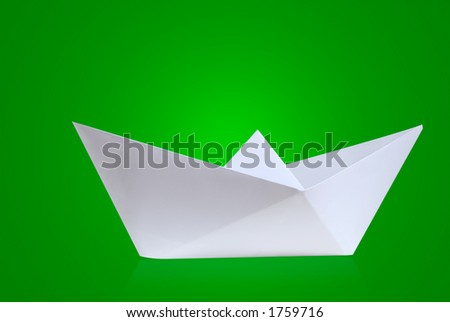 Paper boat with green background - stock photo