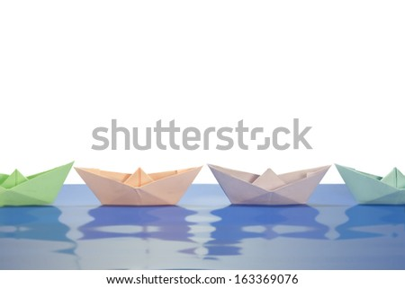 paper boats in different colors - stock photo