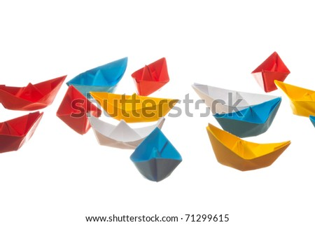 Paper boats on white isolated background