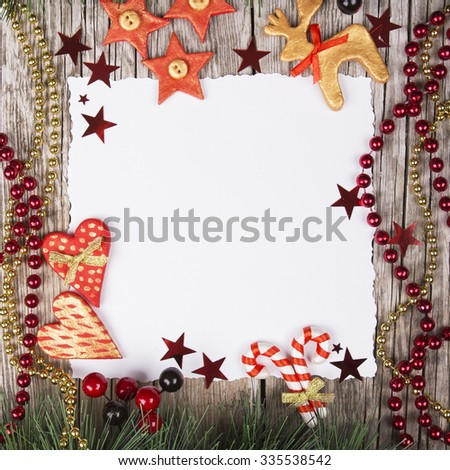 paper bordering with christmas decoration - stock photo