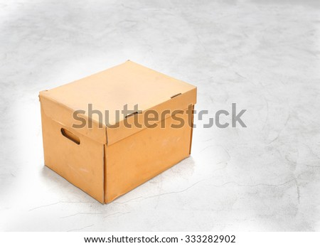 paper brown box on concrete floor