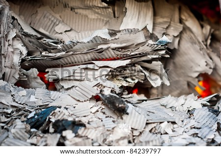 Paper burning in a recycle center - stock photo