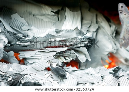 Paper burning in recycle barrel - stock photo