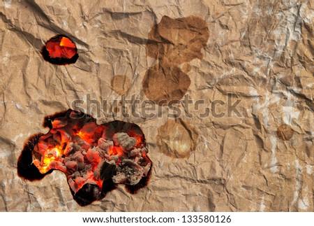Paper burns on coal - stock photo