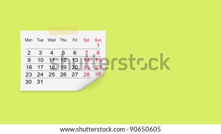 Paper calendar isolated on green wall - stock photo