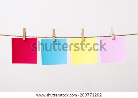 paper cards hanging rope isolated on white background
