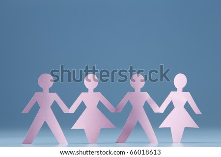 Paper chain holding hands together. - stock photo