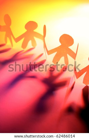 Paper-chain people - stock photo