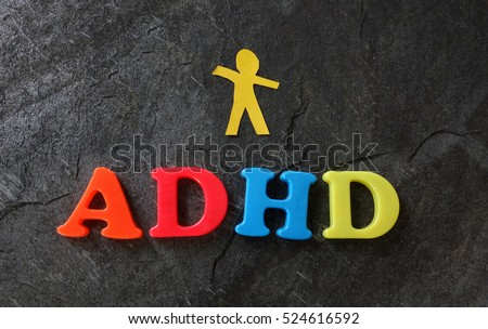 Paper child cutout with ADHD spelled out in play letters