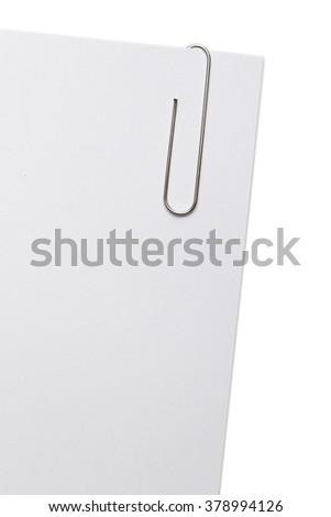 Paper-clip on a corner of white paper sheet.