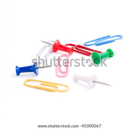 Paper clips and drawing pin isolated on the white background - stock photo