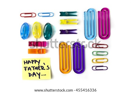 Paper clips set and yellow paper note with the words Happy Fathers Day isolated over a white background - stock photo