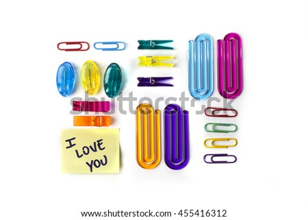 Paper clips set and yellow paper note with the words I love you isolated over a white background - stock photo