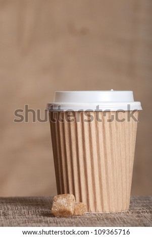 Paper coffee cup over grunge background - stock photo