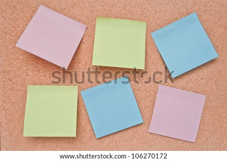 Paper color blank notes on cork board texture.