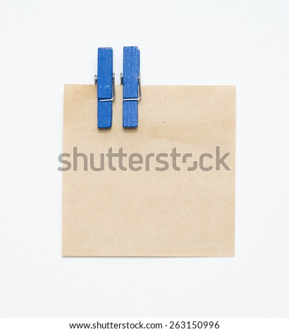 Paper color wood clip note on isolated white background. - stock photo