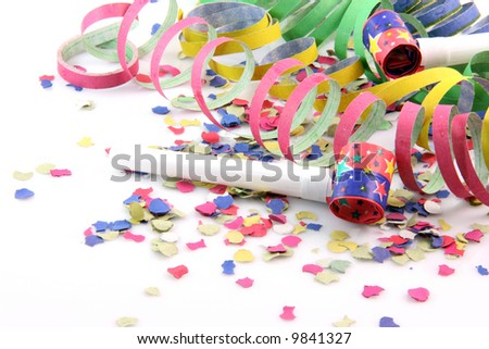 paper confetti with streamers and party blowers on white background with copy space - stock photo
