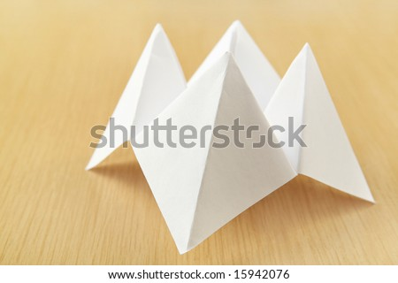 Paper Cootie Catcher fortune telling game - stock photo