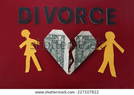 Paper couple with broken dollar heart and Divorce letters                               - stock photo