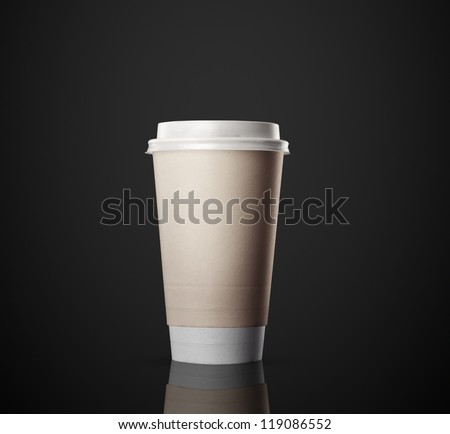 Paper cup of coffee isolated on black background - stock photo