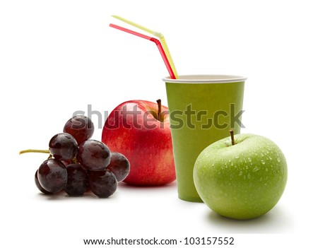 Paper cup with grapes and apples - stock photo