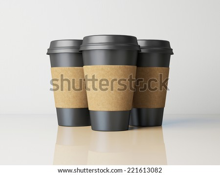 Paper cups with caps on grey background. - stock photo