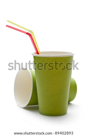 Paper cups with straws on a white background - stock photo