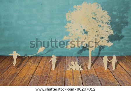 Paper cut of children play - stock photo