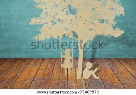 Paper cut of children read a book and  children on swing under tree - stock photo