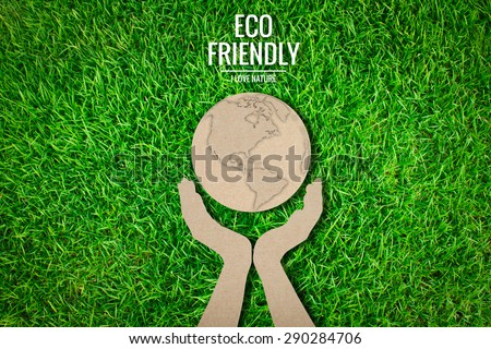 Paper cut of  eco friendly earth on green grass - stock photo