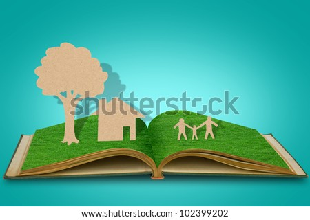 Paper cut of family symbol  on old grass book - stock photo