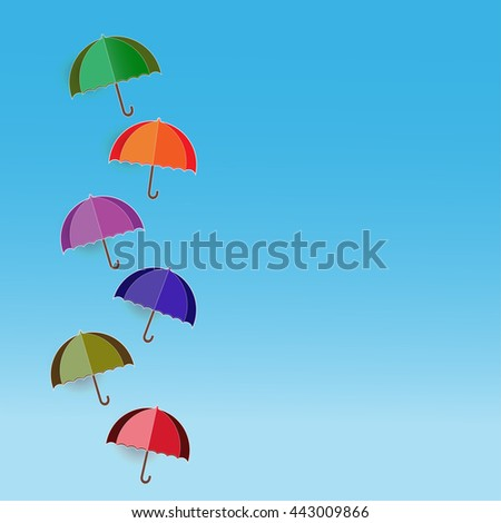 paper cut or origami; paper cut of colorful umbrella with paper cut of blue sky and white clouds background - stock photo