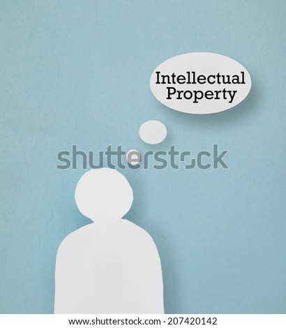 Paper cutout figure with Intellectual Property thought bubble                                - stock photo