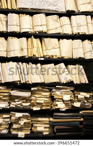 Paper documents stacked in folders as archive - stock photo