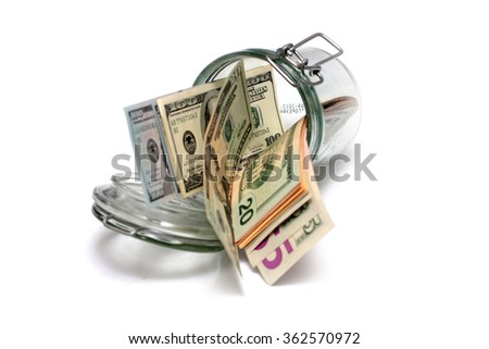 paper dollar notes in a glass jar accumulation